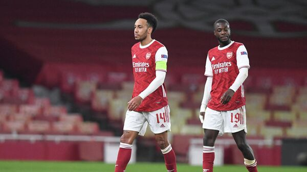 Arsenal's Gabonese striker Pierre-Emerick Aubameyang (L) and Arsenal's French-born Ivorian midfielder Nicolas Pepe react at the final whistle during the UEFA Europa League Round of 16, 2nd leg football match between Arsenal and Olympiakos at the Emirates Stadium in London on March 18, 2021. (Photo by DANIEL LEAL-OLIVAS / AFP)