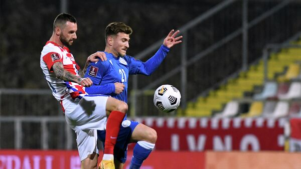 Croatia's midfielder Marcelo Brozovic (L) fights for the ball with Cyprus' forward Marinos Tzionis  during the FIFA World Cup Qatar 2022 qualification Group H football match between Croatia and Cyprus at the HNK Rijeka Stadium, in Rijeka, on March 27, 2021. - Croatia's midfielder Marcelo Brozovic (L) fights for the ball with Cyprus' forward Marinos Tzionis (Photo by Denis LOVROVIC / AFP)