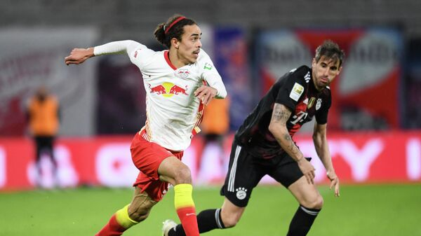 Leipzig's Danish forward Yussuf Poulsen (L) and Bayern Munich's Spanish midfielder Javier Martinez vie for the ball during the German first divison Bundesliga football match between RB Leipzig and FC Bayern Munich in Leipzig, eastern Germany, on April 3, 2021. (Photo by ANNEGRET HILSE / POOL / AFP) / DFL REGULATIONS PROHIBIT ANY USE OF PHOTOGRAPHS AS IMAGE SEQUENCES AND/OR QUASI-VIDEO