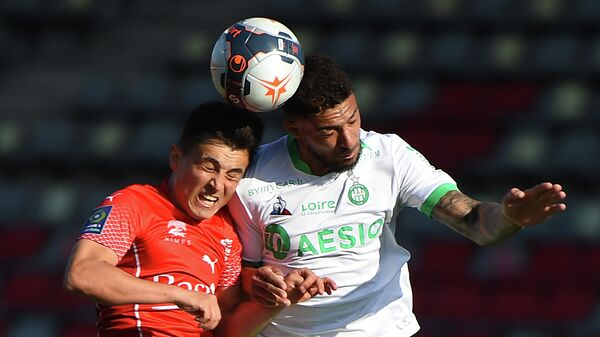 Nimes' Argentine midfielder Andres Cubas (L) fights for the ball with Saint-Etienne's Gabonese forward Denis Bouanga (R) during the French Ligue 1 football match between Nimes Olympique and AS Saint-Etienne (ASSE) at the Costieres stadium in Nimes, Southern France on April 04, 2021. (Photo by Sylvain THOMAS / AFP)