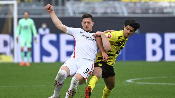 Frankfurt's Serbian forward Luka Jovic (L) and Dortmund's German midfielder Mahmoud Dahoud vie for the ball during the German first division Bundesliga football match between Borussia Dortmund and Eintracht Frankfurt in Dortmund, western Germany, on April 3, 2021. (Photo by Ina Fassbender / POOL / AFP) / DFL REGULATIONS PROHIBIT ANY USE OF PHOTOGRAPHS AS IMAGE SEQUENCES AND/OR QUASI-VIDEO