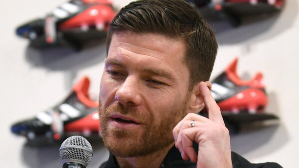 Spanish former footballer Xabier Alonso gestures as he answers questions during a talk session produced by Adidas Japan in Tokyo on January 30, 2018. - Alonso is supervising the team TANGO SQUAD of the football league TANGO LEAGUE sponsored by Adidas. (Photo by Kazuhiro NOGI / AFP)