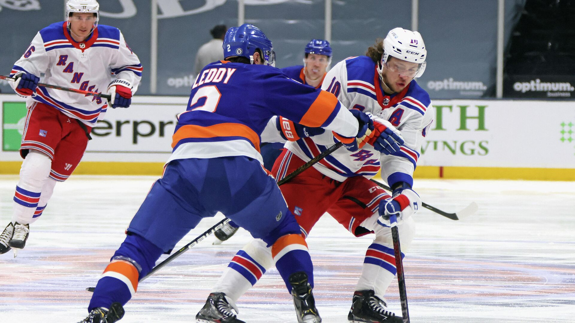UNIONDALE, NEW YORK - APRIL 09: Artemi Panarin #10 of the New York Rangers carries the puck in on Nick Leddy #2 of the New York Islanders at Nassau Coliseum on April 09, 2021 in Uniondale, New York.   Bruce Bennett/Getty Images/AFP (Photo by BRUCE BENNETT / GETTY IMAGES NORTH AMERICA / Getty Images via AFP) - РИА Новости, 1920, 10.04.2021