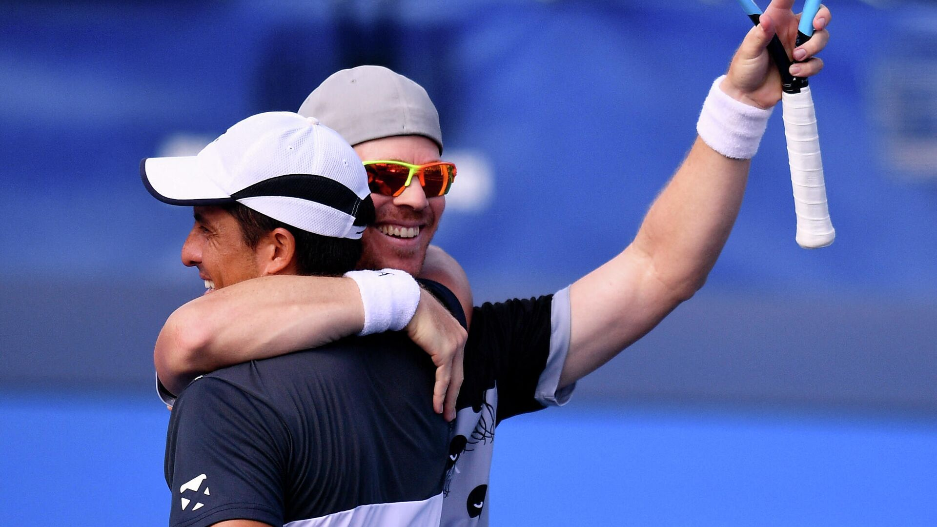 DELRAY BEACH, FLORIDA - JANUARY 13: Ariel Behar of Uruguay and Gonzalo Escobar of Ecuador celebrate after winning against brothers Ryan and Christian Harrison during the Doubles Finals of the Delray Beach Open by Vitacost.com at Delray Beach Tennis Center on January 13, 2021 in Delray Beach, Florida.   Mark Brown/Getty Images/AFP (Photo by Mark Brown / GETTY IMAGES NORTH AMERICA / Getty Images via AFP) - РИА Новости, 1920, 11.04.2021
