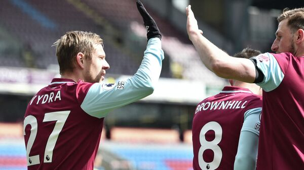 Burnley's Czech striker Matej Vydra (L) celebrates after scoring the first goal  during the English Premier League football match between Burnley and Newcastle United at Turf Moor in Burnley, north west England on April 11, 2021. (Photo by PETER POWELL / POOL / AFP) / RESTRICTED TO EDITORIAL USE. No use with unauthorized audio, video, data, fixture lists, club/league logos or 'live' services. Online in-match use limited to 120 images. An additional 40 images may be used in extra time. No video emulation. Social media in-match use limited to 120 images. An additional 40 images may be used in extra time. No use in betting publications, games or single club/league/player publications. /