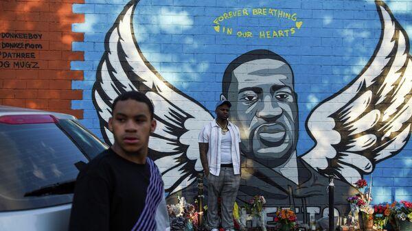 Портрет Джорджа Флойда на стене в Хьюстоне, Техас