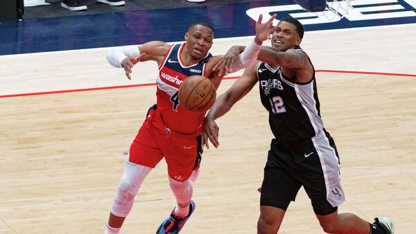 Apr 26, 2021; Washington, District of Columbia, USA; Washington Wizards guard Russell Westbrook (4) reacts after San Antonio Spurs forward Rudy Gay (22) makes contact during the second  half at Capital One Arena. Mandatory Credit: Tommy Gilligan-USA TODAY Sports