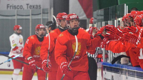 PLANO, TX USA - MAY 3: Russia's Danila Yurov #25 celebrates his first period goal against Belarus with teammates at the players' bench quarterfinal round action at the 2021 IIHF Ice Hockey U18 World Championship at Children's Health StarCenter on May 3, 2021 in Plano, TX USA. (Photo by Ryan McCullough/HHOF-IIHF Images)