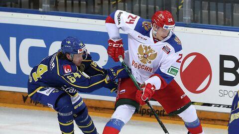 Игровой момент матча сборных России и Швеции по хоккею.