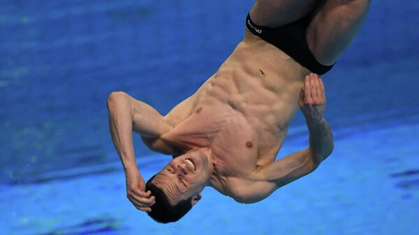 Germany's Patrick Hausding competes in the final of the Men's 1m Springboard Diving event during the LEN European Aquatics Championships at the Duna Arena in Budapest on May 12, 2021. (Photo by Attila KISBENEDEK / AFP)