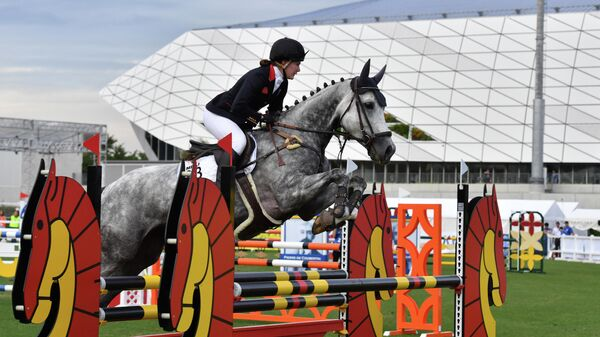 Britain's Kate French jumps during women's individual equestrian event during the UIPM World Cup modern pentathlon test event for the Tokyo 2020 Olympic Games at the AGF field, next to the Musashino Forest Sport Plaza in Tokyo on June 28, 2019. (Photo by Toshifumi KITAMURA / AFP)