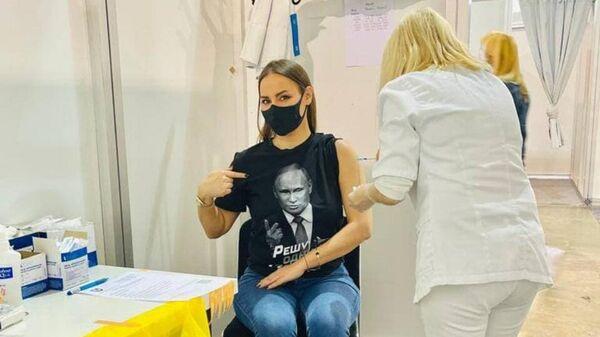 Сербский политик, депутат горсовета Белграда Драгиния Влк привилась Спутником