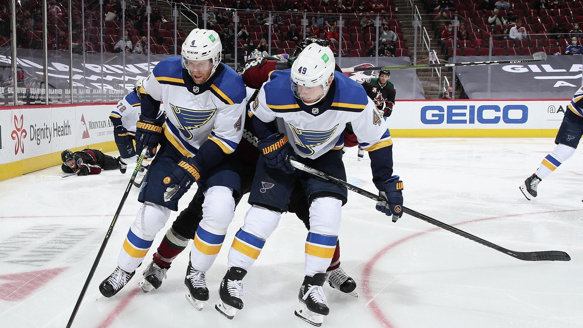 GLENDALE, ARIZONA - FEBRUARY 15: Carl Gunnarsson #4 and Ivan Barbashev #49 of the St. Louis Blues controls the puck during the third period of the NHL game against the Arizona Coyotes at Gila River Arena on February 15, 2021 in Glendale, Arizona. The Coyotes defeated the Blues 1-0.   Christian Petersen/Getty Images/AFP (Photo by Christian Petersen / GETTY IMAGES NORTH AMERICA / Getty Images via AFP) - РИА Новости, 1920, 23.06.2021