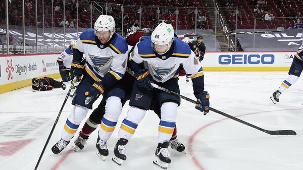 GLENDALE, ARIZONA - FEBRUARY 15: Carl Gunnarsson #4 and Ivan Barbashev #49 of the St. Louis Blues controls the puck during the third period of the NHL game against the Arizona Coyotes at Gila River Arena on February 15, 2021 in Glendale, Arizona. The Coyotes defeated the Blues 1-0.   Christian Petersen/Getty Images/AFP (Photo by Christian Petersen / GETTY IMAGES NORTH AMERICA / Getty Images via AFP)