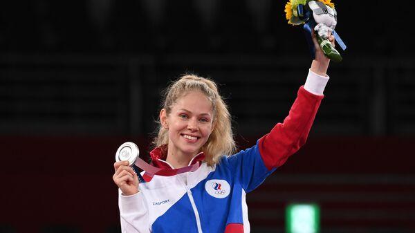 Российская спортсменка, член сборной России (команда ОКР) Татьяна Минина, завоевавшая серебряную медаль на соревнованиях по тхэквондо в весовой категории до 57 кг среди женщин на XXXII летних Олимпийских играх в Токио.