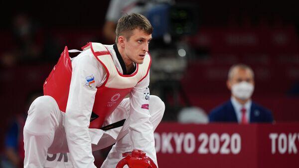 Российский спортсмен, член сборной России (команда ОКР) Владислав Ларин перед началом боя 1/2 финала соревнований по тхэквондо в весовой категории свыше 80 кг среди мужчин на XXXII летних Олимпийских играх в Токио.