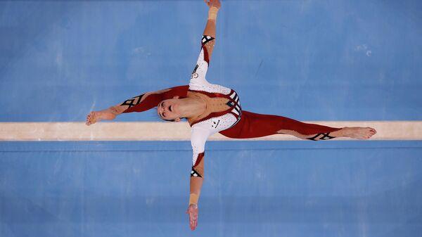 Немецкая спортсменка Паулина Шефер во время квалификационных соревнований по спортивной гимнастике среди женщин на летних Олимпийских играх в Токио