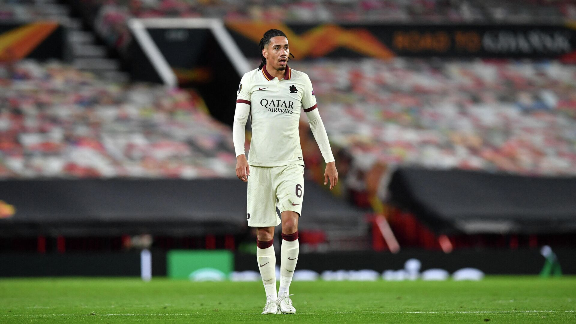 Former United player, Roma's English defender Chris Smalling looks on during the UEFA Europa League semi-final, first leg football match between Manchester United and Roma at Old Trafford stadium in Manchester, north west England, on April 29, 2021. (Photo by Paul ELLIS / AFP) - РИА Новости, 1920, 02.08.2021
