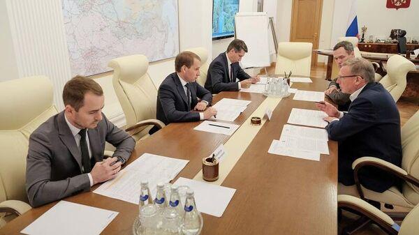 Губернатор Омской области Александр Бурков и глава Минприроды РФ Александр Козлов