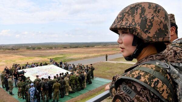 Представительница армии Монголии во время основного этапа учений Запад-2021 на полигоне Мулино в Нижегородской области