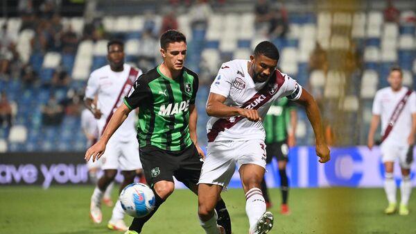 Игровой момент матча Торино - Сассуоло