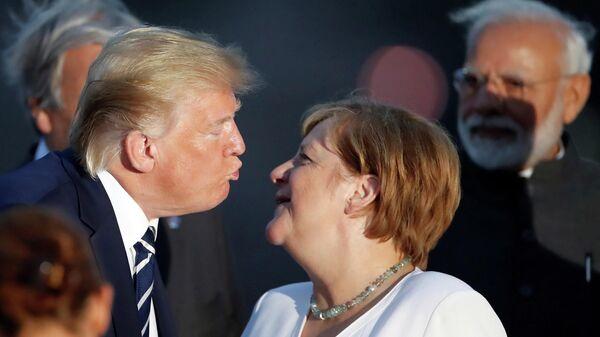 Канцлер Германии Ангела Меркель и Дональд Трамп на саммите G7