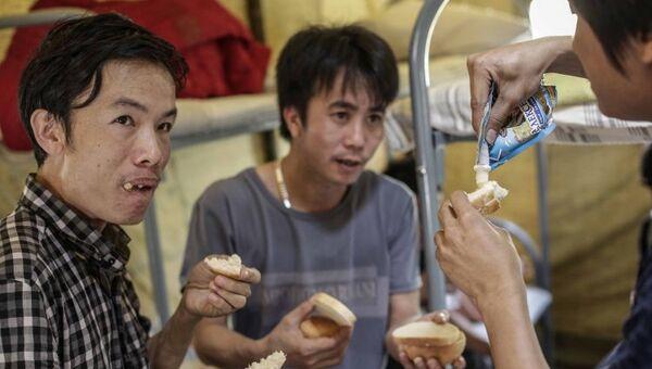 Вьетнамские мигранты. Архивное фото