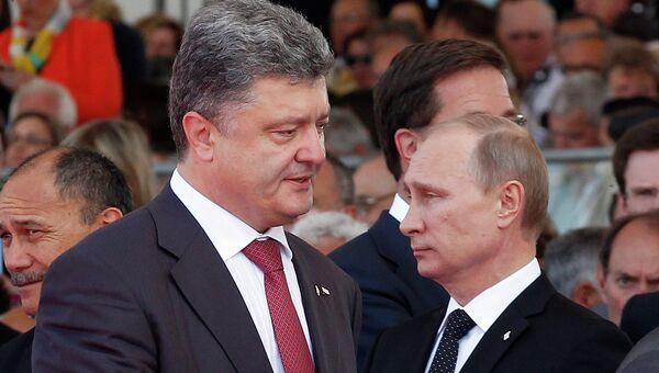 Владимир Путин и Петр Порошенко. Архивное фото.