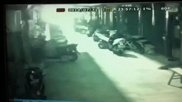 Момент одного из взрывов газа на Тайване. Съемка камеры наблюдения