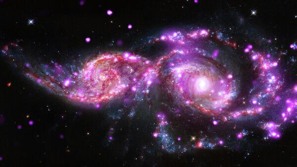 Изображение слияния двух спиральных галактик - GC 2207 и IC 2163