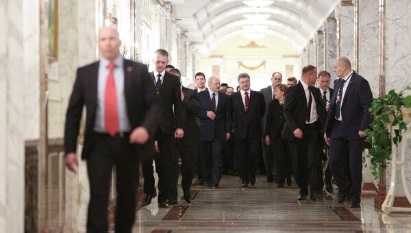 Президент Украины Петр Порошенко, канцлер Германии Ангела Меркель и президент Белоруссии Александр Лукашенко на встрече в Минске. Архивное фото
