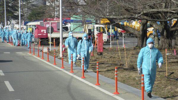 Ликвидаторы аварии на АЭС Фукусима. Архивное фото