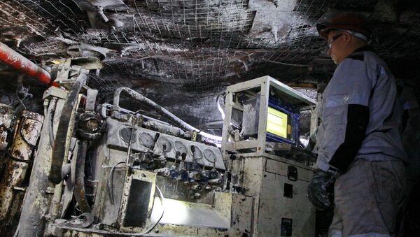 Работник участка подземного бурения на шахте имени С.М. Кирова