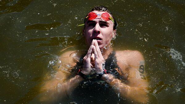 Кирилл Абросимов (Россия) после финиша после финиша на дистанции 10 км на открытой воде среди мужчин на XVI чемпионате мира по водным видам спорта в Казани