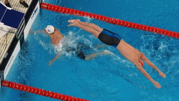 Спортсмены сборной России на дистанции эстафеты на XVI чемпионате мира по водным видам спорта в Казани