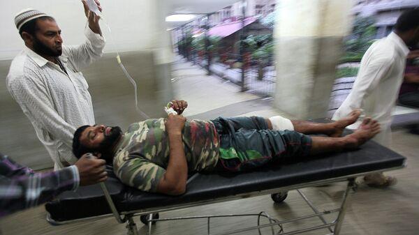Житель, пострадавший в ходе перестрелки на границе с Пакистаном. Кашмир, Индия, 28 августа 2015