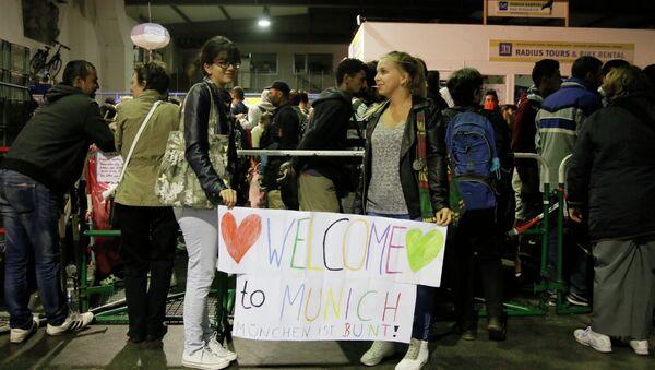 Беженцы с Ближнего Востока на автобусной станции в Мюнхене