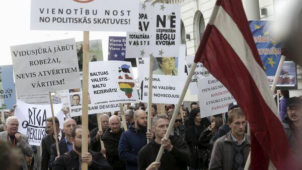 Акция протеста против приема беженцев в Латвии