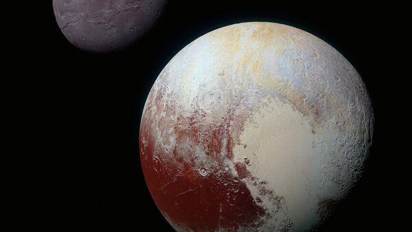 Цветная фотография Плутона и Харона