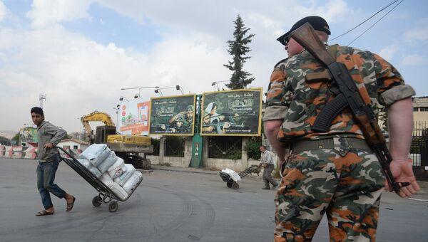 Военнослужащий на одной из улиц Дамаска. Архивное фото
