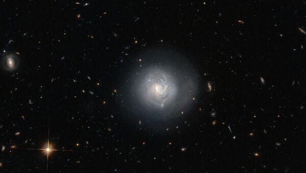 Новое изображение линзовидной галактики МРК 820