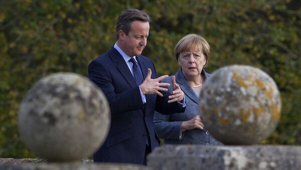 Канцлер ФРГ Ангела Меркель и премьер-министр Великобритании Дэвид Кэмерон во время визита Меркель в Лондон. Октябрь 2015