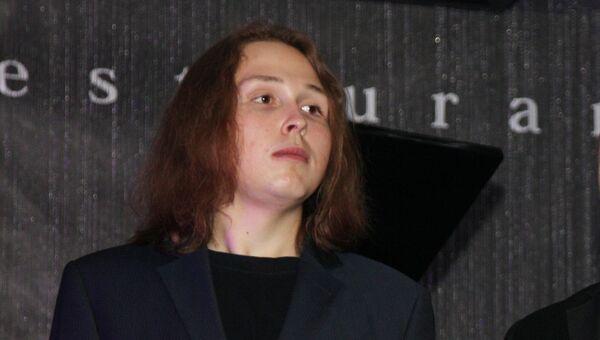 Сын художника Никаса Сафронова Лука Затравкин на праздновании дня рождения Никаса Сафронова. Архив