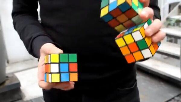 Собрать три кубика Рубика, жонглируя… И за 20 секунд