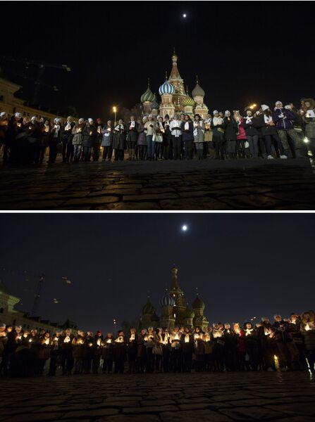Активисты Всемирного фонда дикой природы (WWF) участвуют в экологической акции Час Земли на Красной площади в Москве