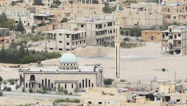 Вид на центральную часть современной Пальмиры, где продолжаются ожесточенные бои между сирийской армией соместно с отрядами народного ополчения Соколы Пустыни и боевиками запрещенной в России организации ИГИЛ