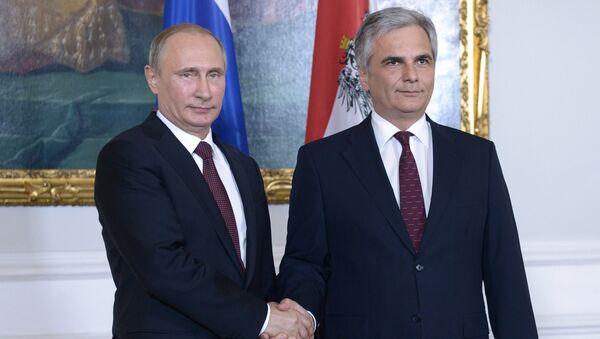 Президент России Владимир Путин и федеральный канцлер Австрийской Республики Вернер Файман во время встречи в Вене. 24 июня 2014