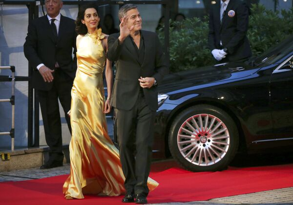 Американский актер Джордж Клуни с женой Амаль