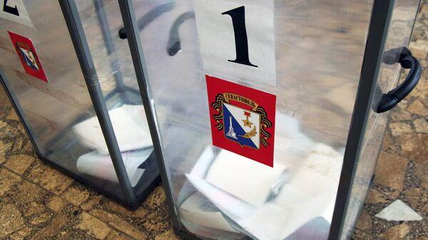 Голосование за кандидатов. Архивное фото