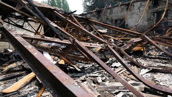 Последствия обстрела в Донбассе, архивное фото